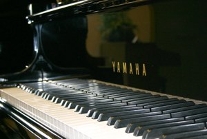 Polished ebony finish: C Series Yamaha piano